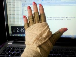 AN IMAK COMPRESSION GLOVE with an elastic support bandage helped with wrist pain, but wrapping and unwrapping was a PITA.