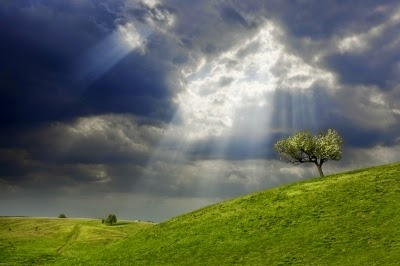 Sun-breaking-thru-storm-clouds-Evgeni-Dinev
