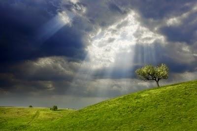 Sun-breaking-thru-storm-clouds-Evgeni-Dinev
